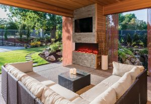 Covered patio exterior behind new luxury home