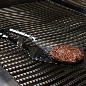 70020_spatula-light_in-use-napoleon-grills